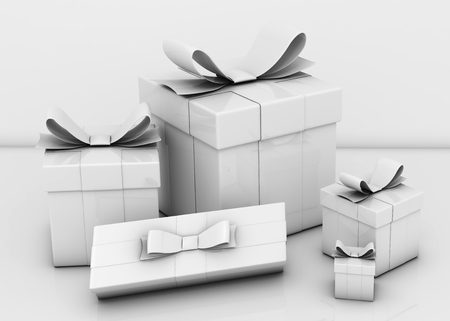 White gift boxes and empty white wall