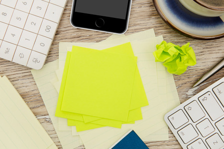 messy: Adhesive note on messy desk Stock Photo
