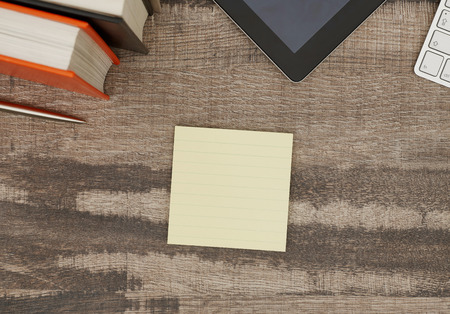 blank note: Blank adhesive note on desk