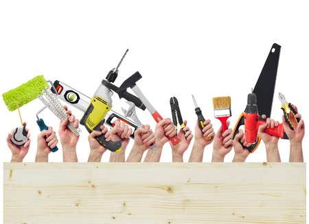 Hands holding tools and wood board Stock Photo