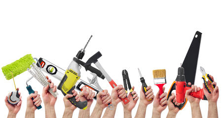 Hands holding tools