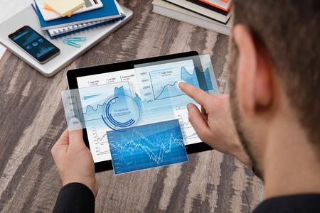 digital display: Businessman using a digital display