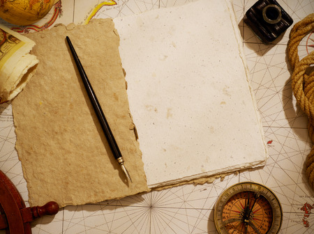 old notebook: Notebook and marine equipment over old map from XVIII century Stock Photo