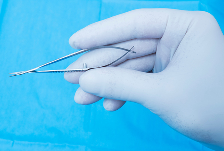 forceps: Hand with forceps Stock Photo
