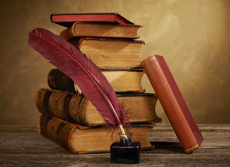 antique books: Ink pot, quill and antique books