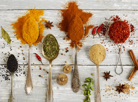 high angle: Variation of spices in spoons Stock Photo