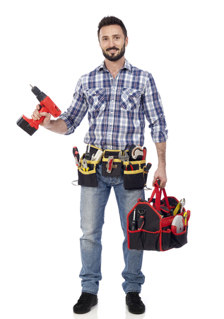 Carpenter with toolbox and drill