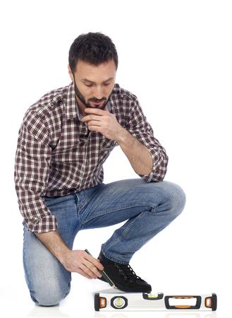 Handyman measuring on floor