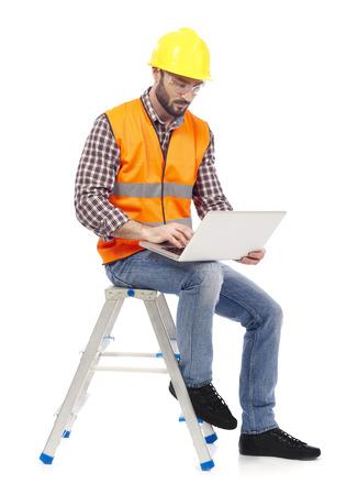 Carpenter with laptop Reklamní fotografie