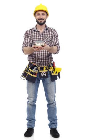 class maintenance: Carpenter showing a house model