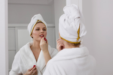 Applying make-up in the mirror