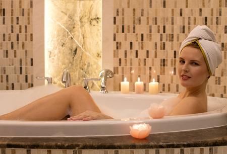 Cheerful woman in the bathtub
