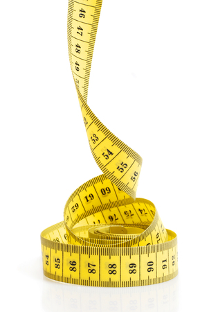 Rolled up yellow tape measure