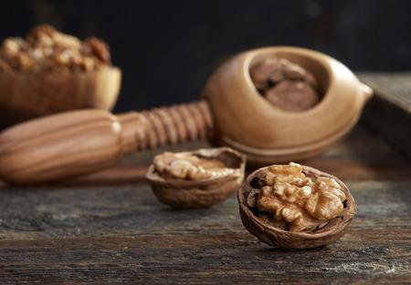 Walnuts and nutcracker close-up