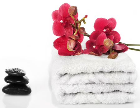 Spa orchid with towels Stock Photo