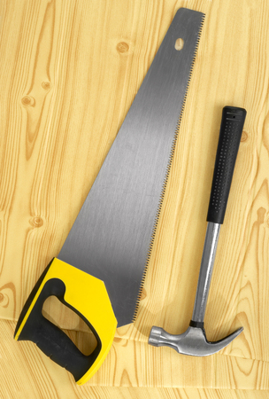 serrated: Hand saw and hammer