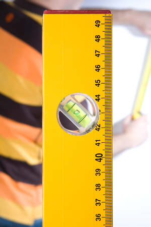 Measuring with level tool Stock Photo
