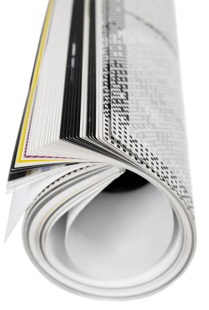 Rolled up magazine Stock Photo