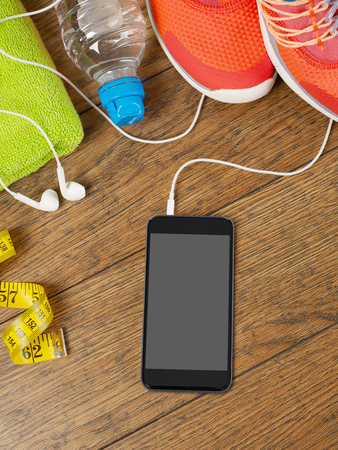 software portability: Mobile phone and sport equipment Stock Photo