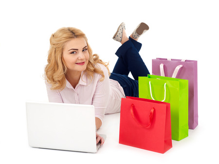 Girl with laptop and shopping bags