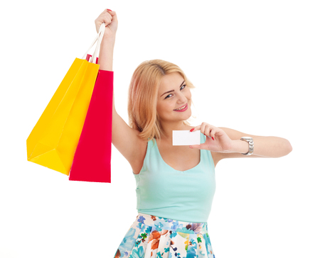 Woman with shopping bags and business card