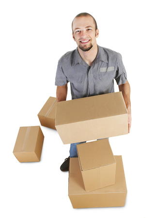Cheerful handyman with boxes