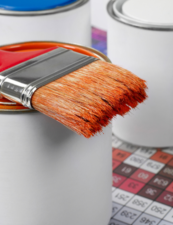 Paint can, paint brush and color swatch Stock Photo