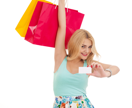 Happy girl with shopping bags and business card