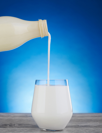 Pouring milk in a glass Stock Photo
