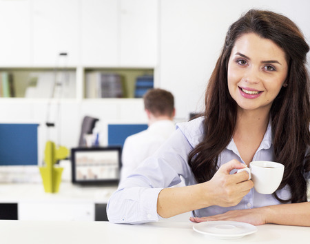 Businesswoman relaxing with a coffee