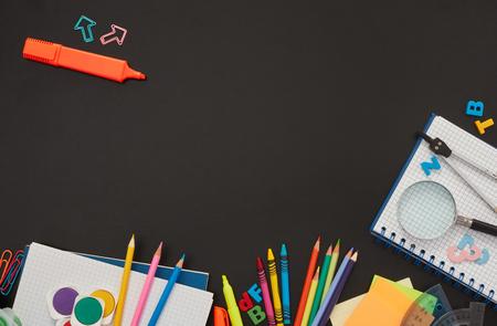 School accessories on blackboard