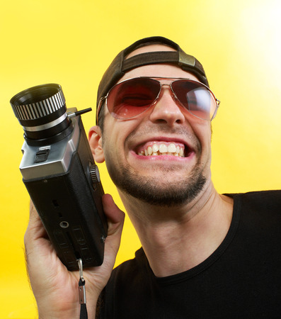 Cameraman with 8mm camera Stock Photo