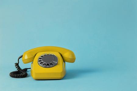 Vintage yellow telephone Imagens
