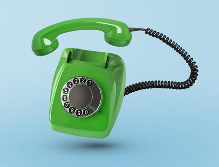 Vintage telephone on blue