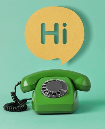 Vintage telephone with Hi speech bubble
