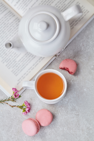 Leisure with book, tea and macaroons 스톡 콘텐츠