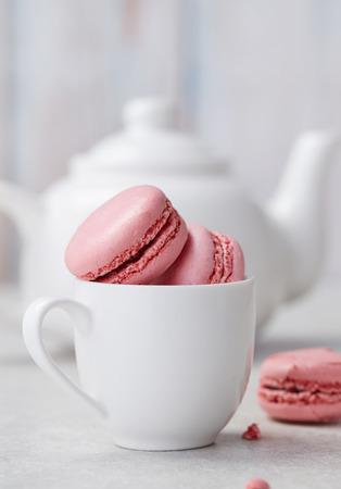 Pink macaroons and tea pot