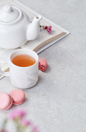 Relaxing tea, macaroons and book 스톡 콘텐츠