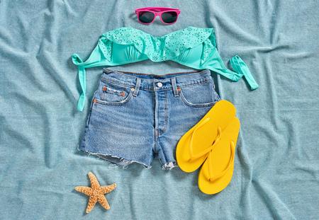 Shorts, flip flops and sunglasses