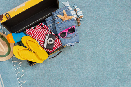 Packing for beach holiday from above