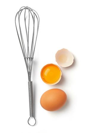 Cracked egg and egg whisk