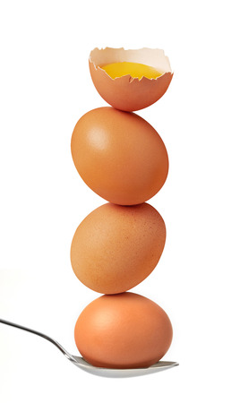 Impossible balanced eggs isolated on white