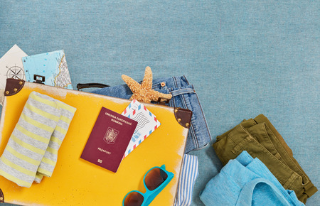 Travel suitcase packing from above Imagens