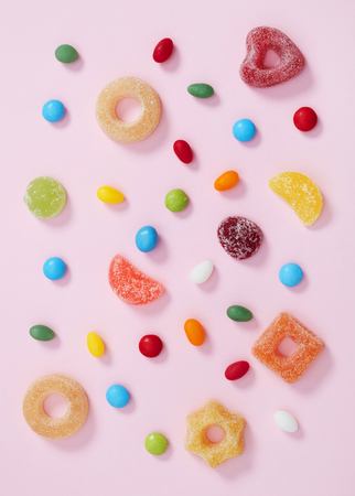 Colorful candy on pink Stock Photo