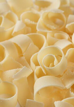 Parmesan cheese flakes closeup background