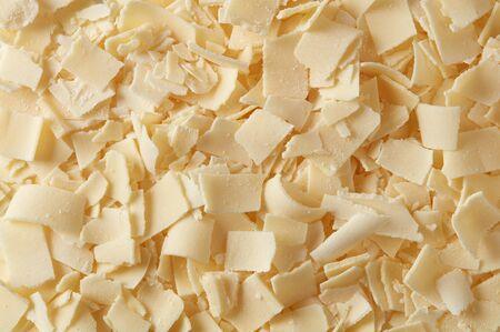 Parmesan flakes closeup detail background