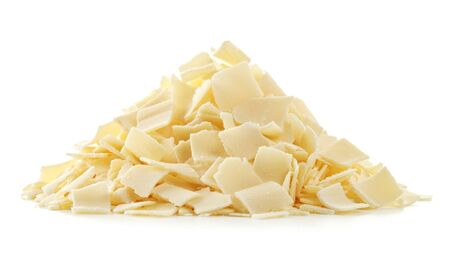 A stack of Parmesan flakes on white