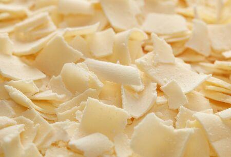 Parmesan cheese flakes close-up detail
