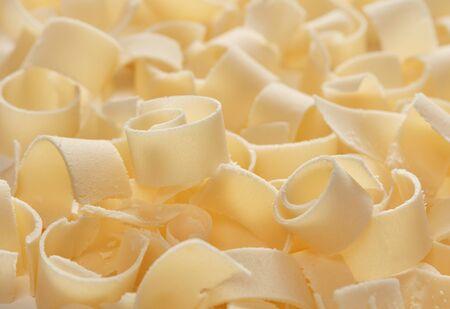 Parmesan flakes close-up detail background Imagens