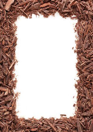 Chopped chocolate frame on white Imagens